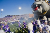 (11/12/11) - (Harrisonburg)James Madison\'s team runs onto the field at the start of their game against Rhode Island at James Madison University in Harrisonburg, Va., Saturday, Nov. 12, 2011.(AP/Daily News-Record)
