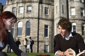 institution_full_993_students_sit_campus_lawn_building_background_uni_stirling_mark_ferguson